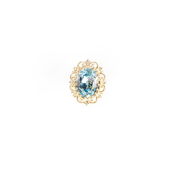 This bright blue topaz crystal ring is the perfect accessory to brighten up any outfit. Size: Adjustable. Gold plated brass. #jewelryforacause #findacure