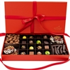 Premium Gift Box of artisanal chocolates, made in Singapore. The box contains an assortment of handmade bonbons and truffles, almond dragees, orangettes, and chocolate mendiants.