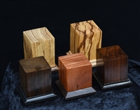 "Wood Bases produced by United Empire.  Various exotic woods measuring approximately 2"" x 2"" x 2"".  Felt Pads and decorative foot included."