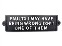Cast iron sign, 'FAULTS I MAY HAVE BEING WRONG ISNT ONE OF THEM'