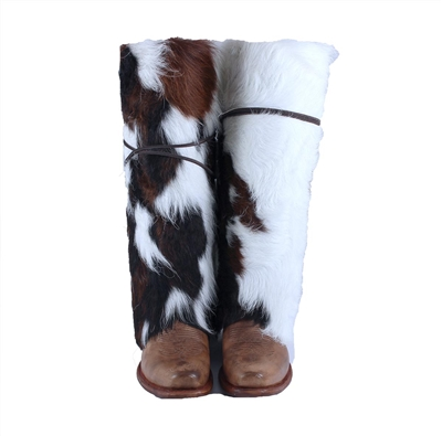 Brown and White Cowhide Boot Rug