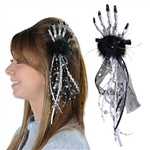 The Skeleton Hand Hair Clip adds a subtle touch to your Halloween outfit. Not overly creepy, it features a silver plastic skeleton hand affixed to a black hair clip. Black feathers, and black tulle fabric feature silver and gold accents. No returns.