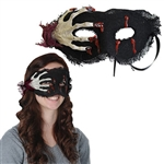 The Skeleton Hand Mask is a fabric covered half mask, adorned with a fake skeleton hand and accented with fake blood. Covered in loosely woven black fabric, with attached tie strings. Sized to fit most heads. Not eligible for returns.