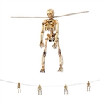 The Skeleton Garland will add some creepiness to any decor. Four miniature plastic skeletons are attached to a 5-foot long jute string. Skeletons measure 6 inches tall and have an antiqued natural color. Completely assembled.