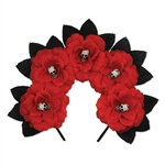 The Day of the Dead Floral Headband is a black headband adorned with red fabric flowers and black leaves. Each flower features a small plastic creepy face bead in the center. One size fits most adults. No returns. One per package.