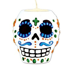 Day of the Dead Male Tea Light Holder - This Day of the Dead Male Tea Light Holder is a stunning replication of the authentic sugar skulls used in traditional Day of the Dead celebrations. Package includes one tea light holder; tea light not included.