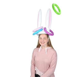 The Inflatable Bunny Ears Ring Toss is made of plastic and includes (1) bunny ears hat with tie chin straps - 16 inches tall, and (4) assorted rings - 7 1/4 inches. No returns. Do not over inflate.