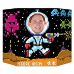 8-Bit Photo Prop is perfect for snapping that fun photo at your next arcade or 80's theme party. Stand the 25-inch tall prop on a flat tabletop, and peer through the cutout area of the spaceman. You're instantly transformed into an arcade alien fighter!
