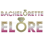 The Bachelorette Streamer is made of cardstock coated in glittered foil and printed on one side. It's gold, silver, and pink and a gold ring icon. It measures 7 inches tall and 6 feet long. Contains one per package. Simple assembly required