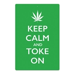 The Keep Calm and Toke On Sign is green with white lettering and it even features the cannabis leaf above the lettering. It measures 13.5 inches wide by 20.25 inches tall and just a couple tacks or pieces of tape will keep this sign up on the wall.