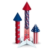 The 3-D Firecracker Centerpiece are red, white, and blue and have different designs of stars and stripes. Sizes range from 7.5 inches to 12.5 inches. Stand measures 6 inches. Made of cardstock. Contains 3 firecrackers and 1 stand per package.