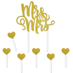 The Mr & Mrs Cake Topper is in gold glittered lettering and includes 6 gold glittered hearts. It measures 5 inches wide and 4 inches high and stands 8 1/4 inches tall. The hearts measure 1 inch and stand 3 1/4 inches tall. Seven total pieces per package.