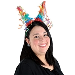 The Pinata Headband is a fun colorful accessory to take your outfit over the top! Attached to a red plastic headband are two cones covered in rainbow colored tissue with colorful ribbons on the tip of each cone. One size fits most. 1 per pack. No returns.