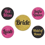 The Team Bride Party Buttons are metal buttons with a pin back. Come in an assortment of designs with sayings including lush, maid of honor, hot mess, selfie queen, and bride. 5 per package. (4) buttons measure 1 3/4 inches and 1 button measures 2 inches