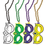 The Mardi Gras Masks w/Beads are made of hard foam board and measure 4 inches by 7 3/4 inches. The beads are 33 inches long. Comes in an assortment of colors: green, gold, purple, and black. The masks are printed with different vibrant designs. 4 per pack