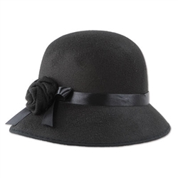 This semi-rigid black felt hat was a popular ladies fashion accessory in the 1920's and 30's. A black satin ribbon and decorative felt flower adorn the side of this hat. Sized to fit most adults, this item is ineligible for returns due to hygiene concerns