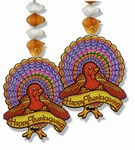 "These Turkey Danglers are thirty (30) inches long.  Cardstock turkeys dangling from the end hold a banner reading ""Happy Thanksgiving."""