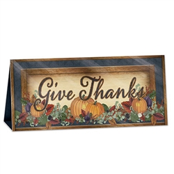 Add a warm and welcoming message to your table with this classic, rustically styled 3-D Foil Fall Thanksgiving Centerpiece.  Fully assembled it stands 6 1/4 inches tall and 131/2 inches wide.  Sure to become a treasured holiday decoration!