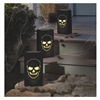 The Boneyard Luminary Bags feature a cutout design of a skull on the front of each black paper bag. Insert some sand to weigh down the bottom, and a battery operated candle to provide an eerie glow. Indoor or outdoor use. 6 luminary bags per package.