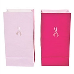 The Luminary Bags - Pink Awareness are made of paper and measure 5 inches wide and 10 inches tall. Each package contains an assortement of dark and light pink colored bags with cutouts in the shape of a ribbon. Total of 12 bags per package.