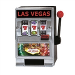 The L.V. Slot Machine Bank is made of plastic and measures 5 inches tall and 3 1/2 inches wide. It has Las Vegas decals and a working handle that spins the reels when you pull it down. Located on the back is a coin slot and a release tab. One per pack.
