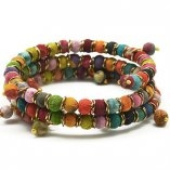 Colorful Wrap Bracelet made with Wooden Beads Wrapped with Recycled Sari Fabrics.