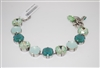 "Amazing Mariana 8"" Bijou Tennis Bracelet with Green Swarovski Crystals from the Fern Collection and .925 Silver Plated"