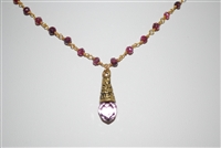 Drop Necklace with Gold Tone Metal Findings and Mauve Crystal Beads