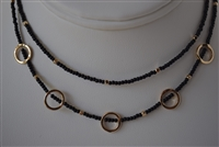 Double Strand Black Choker with Gold Tone Circular Shapes