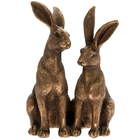 Two Bronze Sitting Hares