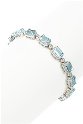 EMERALD CUT AQUAMARINE AND DIAMOND TENNIS BRACELET IN 14K WHITE GOLD