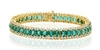 OVAL EMERALD AND DIAMOND BRACELET IN 18K YELLOW GOLD