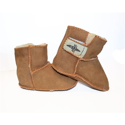 These sheepskin booties are made from the finest Australian Sheepskin. This soft and comfortable high-top shearling sheep skin boot will keep your baby or toddler warm while being in style. Feature a quick and easy velcro closure. Now your little one...