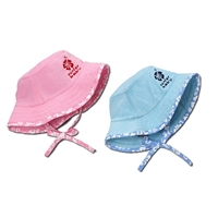 Our Surfer Baby cotton terry bucket hat will protect your little one from sun exposure. Great for the beach, park, sandbox, stroller, walks, or playing out in the yard! In pink, blue or green cotton terry with matching aloha print trim....