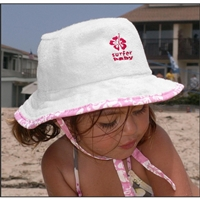 Our Surfer Baby cotton terry bucket hat will protect your little one from sun exposure. Great for the beach, park, sandbox, stroller, walks, or playing out in the yard! White cotton terry trimmed in aloha print, the hat ties under the...