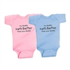 """My daddy surfs better than your daddy"" Available in soft 100% baby rib combed cotton one pieces.  Colors: Blue and Pink. Sizes: 6 mo., 12 mo., and 18 mo...."