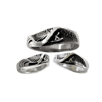 This wave ring is hand carved, made from Lead Free Pewter with beautiful natural undercuts to resemble a perfect deep barrel.  100% Handcarved. .925 Sterling Silver. Made in Carlsbad, California USA
