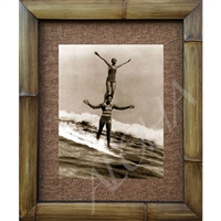 """Duke Kahanamoku Tandem Surfing"" Classic photograph of Duke Kahanmoku in a perfect stance, tandem surfing on vintage wooden surfboard. Matted in a Natural Grass Mat and framed in a handmade Natural Bamboo Frame. Bamboo Frame is hand sanded and..."
