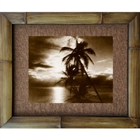 """Sunset Palms"" Vintage Hawaiian photograph of palm trees in the foreground of a sunset over the ocean.Matted in a Natural Grass Mat and framed in a handmade Natural Bamboo Frame. Bamboo Frame is hand sanded and stained twice. Made in California, USA...."