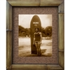 """Young Duke Kahanomoku with Surfboard"" circa 1920's. Iconic photograph of Duke Kahanamoku with his classic ""Duke"" surfboard. Does'nt get better than this. Matted in a Natural Grass Mat and framed in a handmade Natural Bamboo Frame. Bamboo Frame is..."