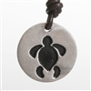 Beautiful Round Sea Turtle Pewter Pendant Design from Zulasurfing. Contemporary Round design made of pewter with satin finish and Brown Greek leather cord.Proudly Made In The U.S.A.All jewelry comes in an elegant gift box....