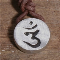 Handmade itemMaterials: pewter,  leatherShips worldwide from United StatesThis is an Amazing Om Pendant Sanskrit symbol Hindu Yoga Reiki Art.my contemporary design to this old and meaningful symbol, thick piece of pendant with a drill through for...