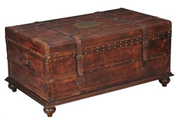 brown leather trunk coffee table brass nail heads strap buckles wood base bun feet Sarreid Ltd.