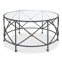 round coffee table glass top iron base old iron gray brass detail