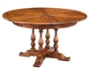 Sarreid, Ltd. round wood walnut stained dining table expandable adjustable four turned legs stored leaves