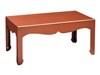 red coffee table curved detail gold accents