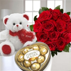 Roses bouquet, teddy bear and Ferrero Rocher chocolates.