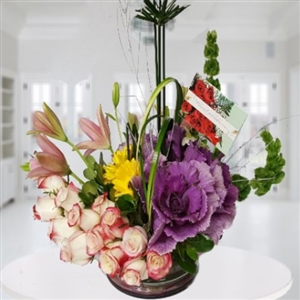 Arrangement of roses, lilies and tropical flowers. Available for Bogota only.