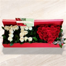 I love you arrangement in box with chocolate strawberries.