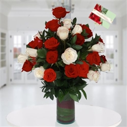 Two dozen red and white roses in glass vase